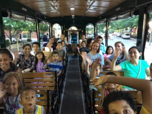 Families on board the APS Traveling Trolley