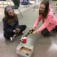 Students testing robotic arm prototype