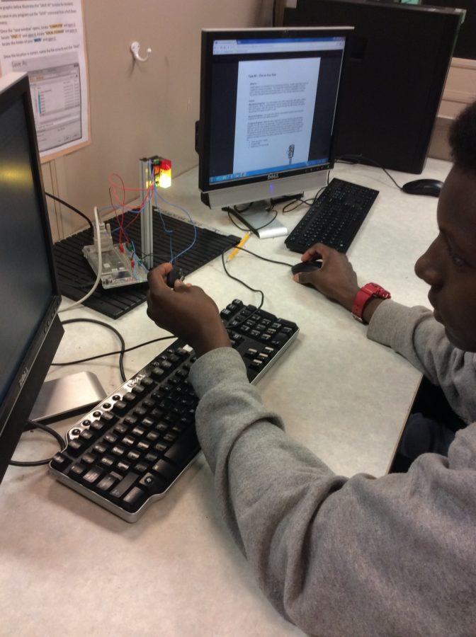 Tech Ed programming their traffic lights