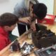 Students taking apart items to learn what they are made from