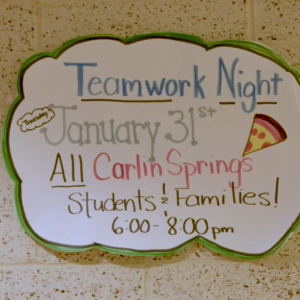 sign for Teamwork Night at Carlin Springs