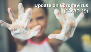 girl holding up soapy hands, with text Update on Coronavirus (COVID-19)