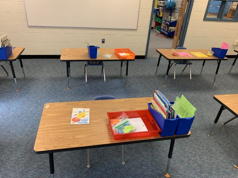typical elementary desk with materials bins