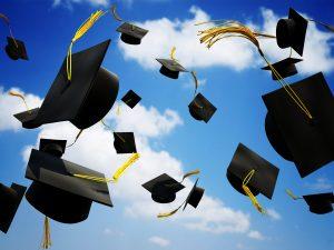 graduation caps tossed in air