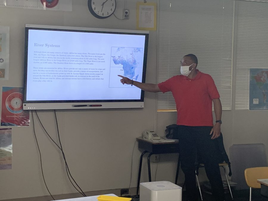 teacher in front of smart board
